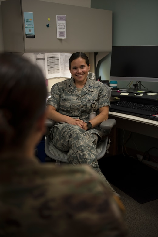 Capt. Felicia Keith, 60th Medical Operations Squadron director of psychological health, listens to one of her patients during a treatment session at David Grant USAF Medical Center at Travis Air Force Base, Calif., June 25, 2018. Keith and her team of professionals have treated more than 200 people who displayed post-traumatic stress symptoms over the past year. Badge blurred for security reasons. (U.S. Air Force photo by Tech. Sgt. James Hodgman)