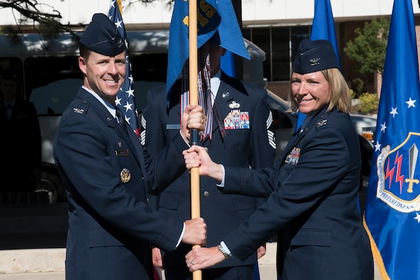 Col. Todd Moore, 21st Space Wing commander, passes the guidon to Col. Kirsten Aguilar as she assumes command of the 21st Mission Support Group at Patriot Park on Peterson Air Force Base, Colorado, June 26, 2018. Formerly, Aguilar served as the executive assistant to the deputy commander, U.S. Pacific Command, providing operational and strategic guidance to the deputy commander on national security issues involving over 30 allied and partner nations. (U.S. Air Force photo by Robb Lingley)