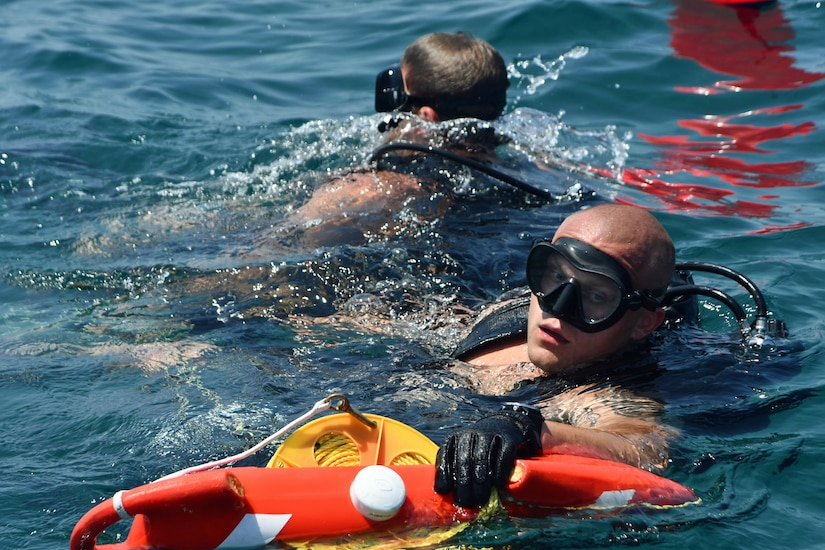 Explosive Ordnance Disposal (EOD) Technician 2nd Class Matt Strong (right) and EOD Technician 3rd Class Joe Krzemien return to the boat following a dive during exercise Resolute Response (RR) 18. RR18 is a bilateral EOD, diving and visit, board, search and seizure engagement with the U.S. and Lebanese Armed Forces to enhance military-to-military cooperation and counter maritime threats (U.S. Navy photo by Mass Communication Specialist 1st Class Bryan Neal Blair/Released)