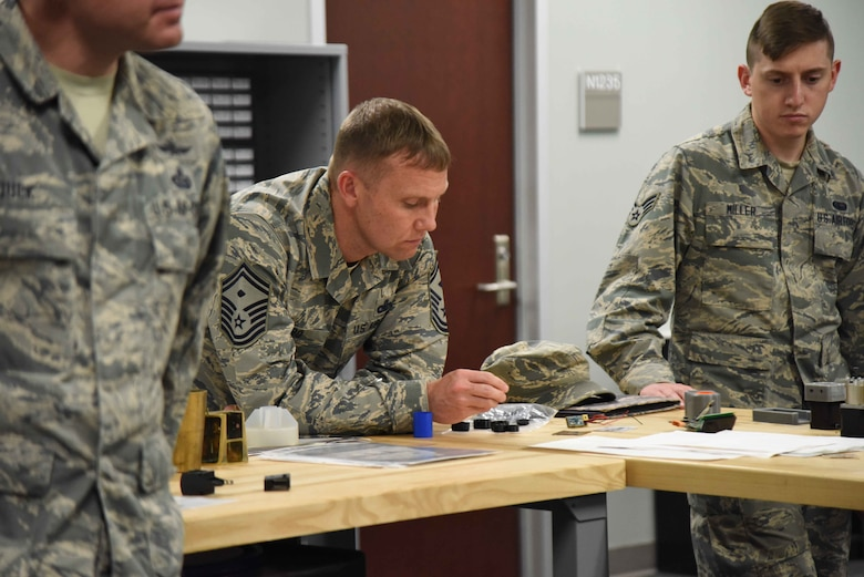 Senior Master Sgt. Scott Gero, a first sergeant at the 363rd Intelligence, Surveillance and Reconnaissance Wing, Langley AFB, Va., looks over some projects produced by members of the Air Force Technical Applications Center's Innovation Lab during a visit June 1, 2018.  Gero, along with 35 other Airmen across the Air Force ISR enterprise, visited the nuclear treaty monitoring center at Patrick AFB, Fla., to learn more about how AFTAC employs innovation to improve mission accomplishment.   (U.S. Air Force photo by Susan A. Romano)