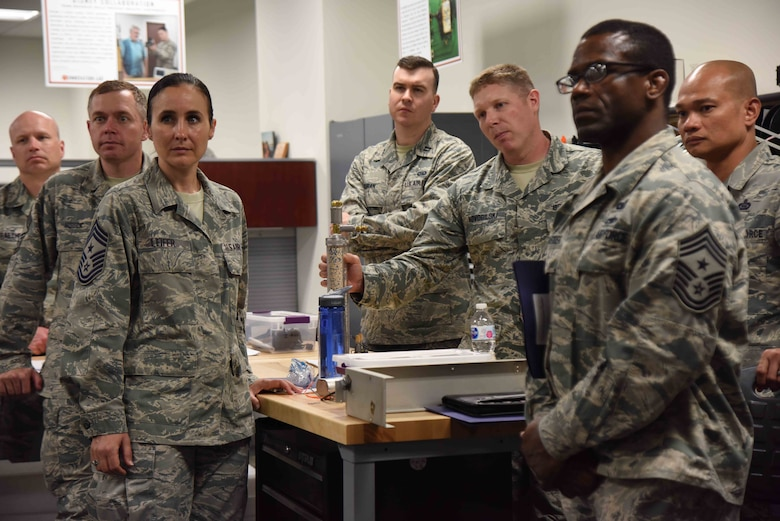 Leaders from across 25th Air Force's Intelligence, Surveillance and Reconnaissance community listen as members of the Air Force Technical Applications Center brief them on how the center uses innovation to develop and streamline technologies and processes at a cheaper cost while simultaneously addressing mission gaps.  Thirty-five ISR Airmen visited the nuclear treaty monitoring center June 1, 2018.  (U.S. Air Force photo by Susan A. Romano)