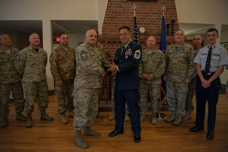 Chief Master Sgt. Brian Preyna, 23d Maintenance Group superintendent, presents an award to Chief Master Sgt. Jay Banghart, 23d Maintenance Squadron operations chief, during a retirement ceremony, July 6, 2018, at Moody Air Force Base, Ga. Banghart retired after serving 28 years in the Air Force in numerous positions within the aircraft maintenance career field. (U.S. Air Force photo by Airman Taryn Butler)