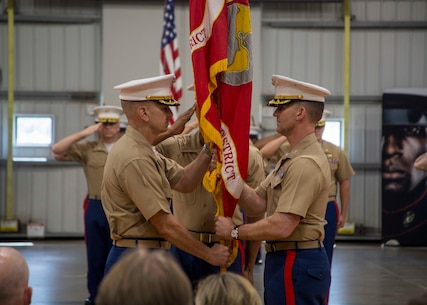Colonel Jeffrey C. Smitherman, the outgoing Commanding Officer of 6th Marine Corps District (MCD), passes the unit colors during the 6th MCD change of command ceremony at Parris Island, South Carolina, July 2, 2018. During the ceremony, Smitherman relinquished his command to Col. William C. Gray, the oncoming Commanding Officer of 6th MCD. (U.S. Marine Corps Photo by Lance Cpl. Jack A. E. Rigsby)