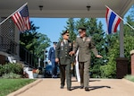 Marine Corps Gen. Joe Dunford, chairman of the Joint Chiefs of Staff, and Thai Army Gen. Tarnchaiyan Srisuwan, chief of the Defense Force, walk out to Whipple Field for an honors ceremony on Joint Base Myer - Henderson Hall, Virginia; July 9, 2018.