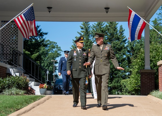 Marine Corps Gen. Joe Dunford, chairman of the Joint Chiefs of Staff, and Thai Army Gen. Tarnchaiyan Srisuwan, chief of the Defense Force, walk out to Whipple Field for an honors ceremony on Fort Myer, July 9, 2018.