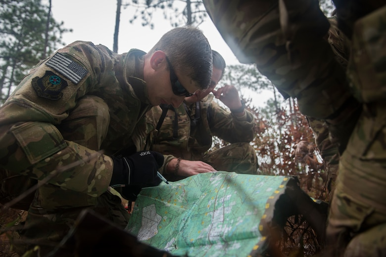 U.S. Air Force Aircrew members with the 1st Special Operations Wing evade opposing forces during combat survival training at the Eglin Range, Fla., on Dec. 7, 2017.