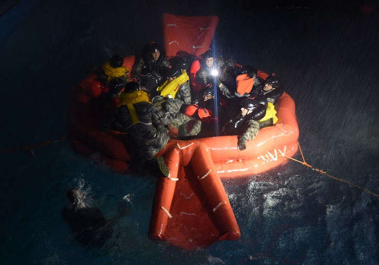 U.S. Air Force Airmen assigned to Royal Air Force Lakenheath survive the simulated heavy wind, rain and waves on a 20-man life raft during a Water Survival Course at East Coast College, Lowestoft, England, on May 4, 2018.