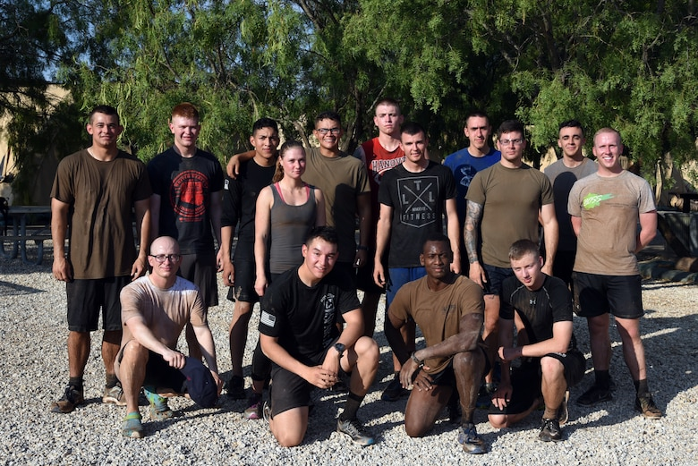 A group of 344th Military Intelligence Battalion soldiers pose for a photo after the during the 344th MI BN mud run at the Camp Sentinel training area on Goodfellow Air Force Base, Texas, July 7, 2018. This was an Army exclusive event that the 344th MI BN used as a test run before opening it up to a larger audience at a later time. (U.S. Air Force photo by Staff Sgt. Joshua Edwards/Released)