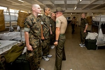 Sergeant Marco A. Casillas, drill instructor, Delta Company, 1st Recruit Training Battalion, corrects a recruit during pick up at Marine Corps Recruit Depot San Diego, June 29.