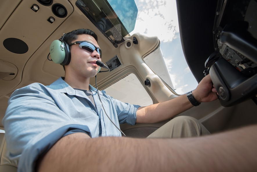 Cadet James Huang, North Gwinnett High School, Suwanee, Georgia, sits in the cockpit of a trainer aircraft at Auburn University, Alabama. Huang is one of 120 cadets selected for a Flight Academy scholarship by Air Force Junior ROTC. The Chief of Staff of the Air Force Flight Academy scholarship program allows selected Air Force Junior ROTC cadets to attend an accredited aviation program at one of six partnering universities to get a private pilot license. (U.S. Air Force photo by Airman Matthew Markivee)
