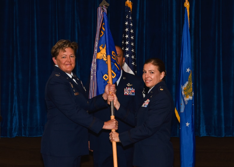 Colonel Tricia Van Den Top, 90th Mission Support Group commander, passes the guidon to Maj. Isabella Ramirez, 90th Force Support Squadron commander, during the 90th FSS change of command ceremony July 9, 2018, on F.E. Warren Air Force Base, Wyo. The ceremony signified the transition of command from Lt. Col. Shannon Hughes. (U.S. Air Force photo by Airman 1st Class Braydon Williams)