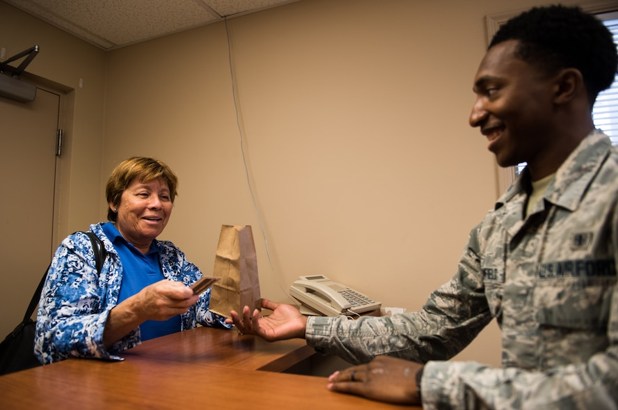 Senior Airman Cole Broomfield, 56th Medical Squadron pharmacy technician, provides a patient with their prescription medicine July 2, 2018 at the Luke Air Force Base Pharmacy Annex in Scottsdale, Ariz.  On average, the Luke AFB Pharmacy Annex, located in the east valley of Phoenix, serves prescription medicine to approximately 150 to 200 patients per week. (U.S. Air Force photo by Airman 1st Class Alexander Cook)