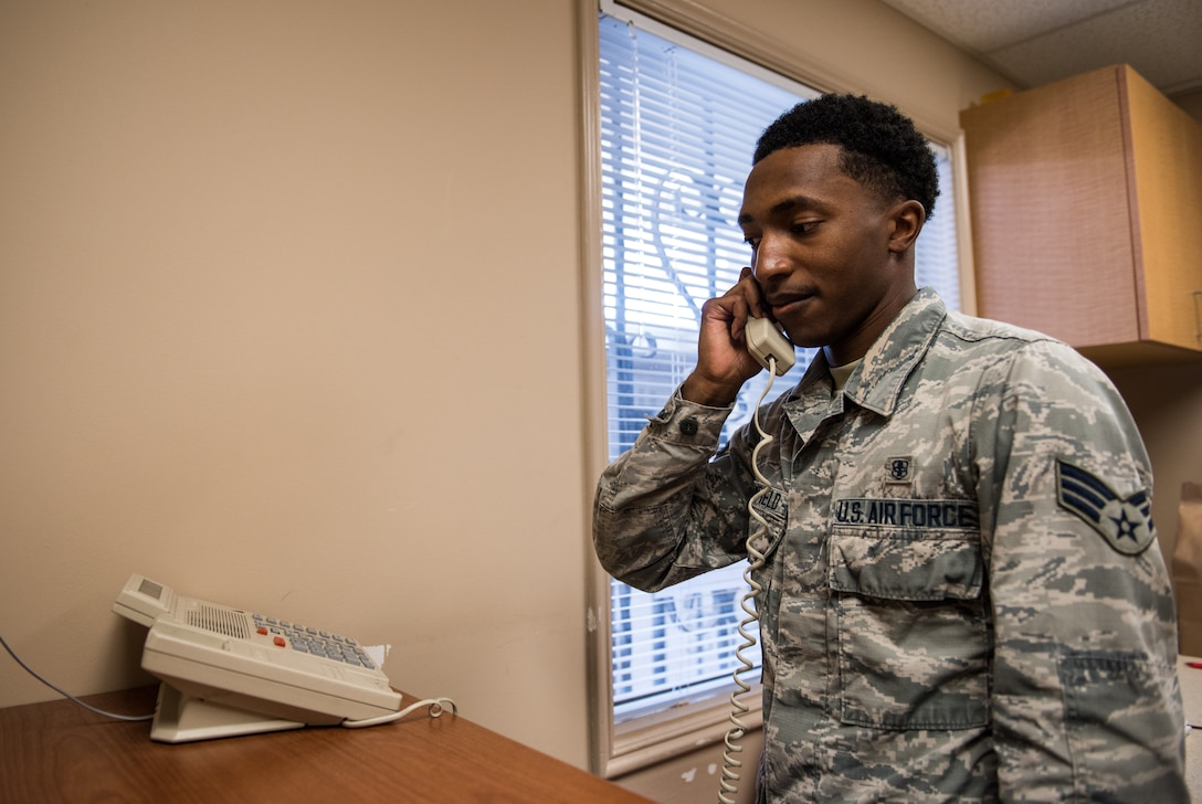 Senior Airman Cole Broomfield, 56th Medical Squadron pharmacy technician, speaks with a patient on the phone July 2, 2018 at the Luke Air Force Base Pharmacy Annex in Scottsdale, Ariz. The Luke AFB Pharmacy Annex, open every Monday and Thursday, provides pharmaceutical services to active duty, retired and veteran service members, as well as their families. (U.S. Air Force photo by Airman 1st Class Alexander Cook)