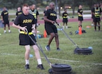 Pfc. Alex Colliver, foreground, pulls a 90-pound sled 50 meters that simulates the strength needed in pulling a battle buddy out of harm's way during a pilot for the Army Combat Fitness Test, a six-event assessment designed to reduce injuries and replace the current Army Physical Fitness Test.