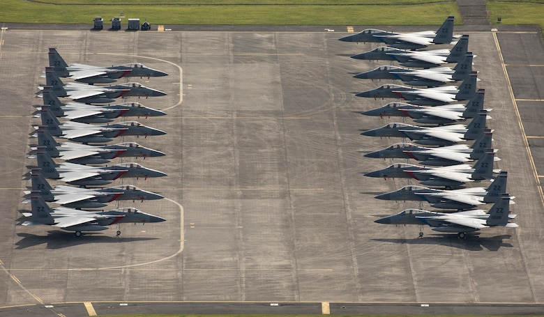 Eighteen U.S. Air Froce F-15 Eagles from Kadena Air Base are parked on the ramp, July 9, 2018