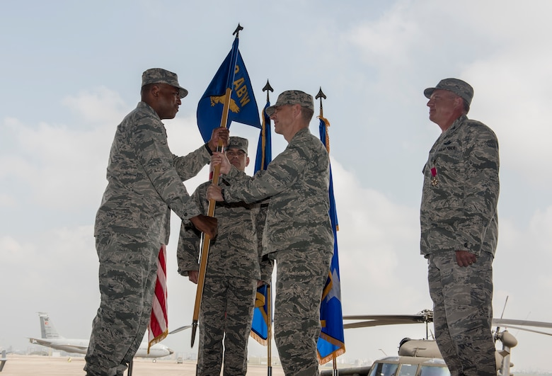 U.S. Air Force Lt. Gen. Richard M. Clark, 3rd Air Force commander, passes a guidon to U.S. Air Force Col. Britt Hurst, 39th Air Base Wing incoming commander, during a change of command ceremony at Incirlik Air Base Wing, Turkey, July 10, 2018.