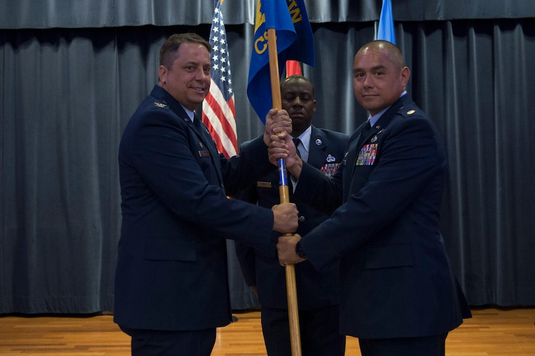 U.S. Air Force Col. Steven M. Zubowicz, 52nd Mission Support Group commander, gives the ceremonial guidon to Maj. Michael C. Murphy, incoming 52nd Communications Squadron commander, during the 52nd CS change of command ceremony at Spangdahlem Air Base, Germany, July 10, 2018. (U.S. Air Force photo by Airman 1st Class Jovante Johnson)