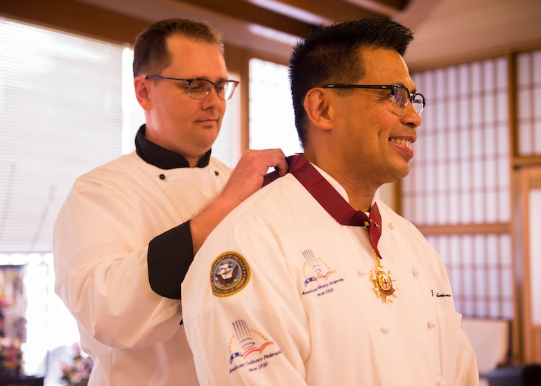 YOKOSUKA, Japan -- (July 10, 2018) -- Senior Chief Culinary Specialist Jerome Feliciano is awarded the World Master Chefs Society's medal in culinary excellence during an award ceremony at the Jewel of the East Galley on board U.S. Fleet Activities (FLEACT) Yokosuka, Japan, July 10, 2018. The World Master Chefs Society selected Feliciano to receive the Master Chefs Diploma of Culinary Excellence in July, making him the fifth active duty enlisted service member to receive the honor in the history of Department of Defense.