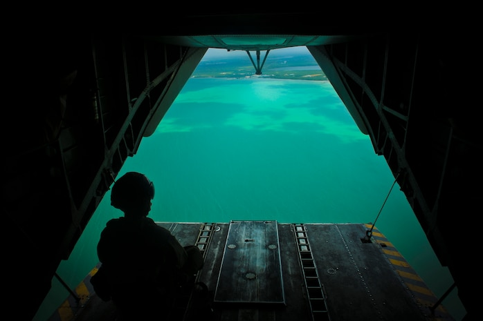 U.S. Marine Staff Sgt. David B. Scranton, a CH-53E Super Stallion helicopter crew chief with Special Purpose Marine Air-Ground Task Force - Southern Command, scans the water below his aircraft during a flight near the coast of Belize, July 8, 2018. The SPMAGTF-SC aviation detachment conducted this exercise to prepare for transporting Marines from ship to shore in the event of a natural disaster or humanitarian operation. The Marines and sailors of SPMAGTF-SC are conducting security cooperation training and engineering projects alongside partner nation military forces in Central and South America. The unit is also on standby to provide humanitarian assistance and disaster relief in the event of a hurricane or other emergency in the region.