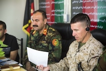 HELMAND PROVINCE, Afghanistan (June 21, 2018) – U.S. Marine Corps Brig. Gen. Benjamin T. Watson, the commanding general of Task Force Southwest, and Maj. Gen. Wali Mohammed Ahmadzai, the commanding general of the Afghan National Army (ANA) 215th Corps, attend a brigade commander's conference at Camp Shorabak. The commander's conference was held by Ahmadzai to develop the Corps' leadership and provide a shared vision moving forward. (U.S. Marine Corps photo by Sgt. Luke Hoogendam)