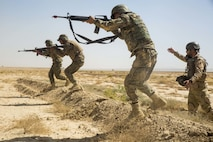 HELMAND PROVINCE, Afghanistan (June 20, 2018) - Afghan National Army (ANA) 215th Corps soldiers bound as a squad toward a notional enemy during a range at Camp Shorabak. The ANA soldiers conducted squad attacks during a training exercise as part of the Operational Readiness Cycle, which is a training segment designed to enhance ANA soldiers' infantry skills and bolster overall unit effectiveness. (U.S. Marine Corps photo by Sgt. Luke Hoogendam)