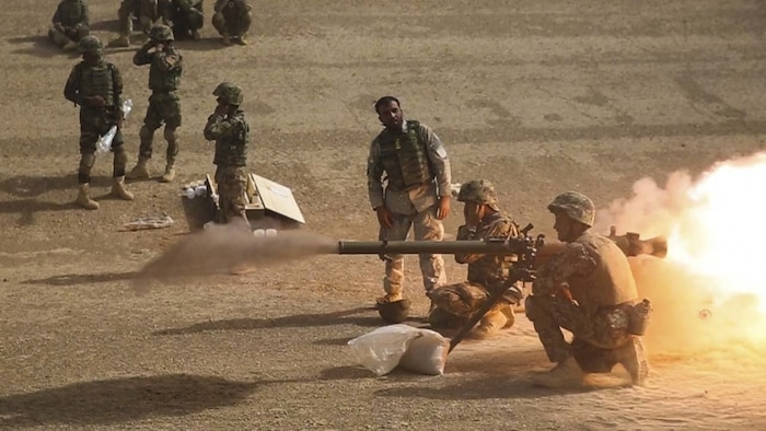 HELMAND PROVINCE, Afghanistan (June 20, 2018) – A soldier with 2nd Kandak, 2nd Brigade, Afghan National Army (ANA) 215th Corps fires an SPG-9 recoilless rifle during a live-fire range supervised by ANA instructors at Camp Shorabak. ANA soldiers fired live rounds to familiarize themselves with the weapon system while simultaneously building their confidence and enhancing the unit's overall proficiency for future operations in the battlefield. (U.S. Marine Corps photo by Sgt. Luke Hoogendam)