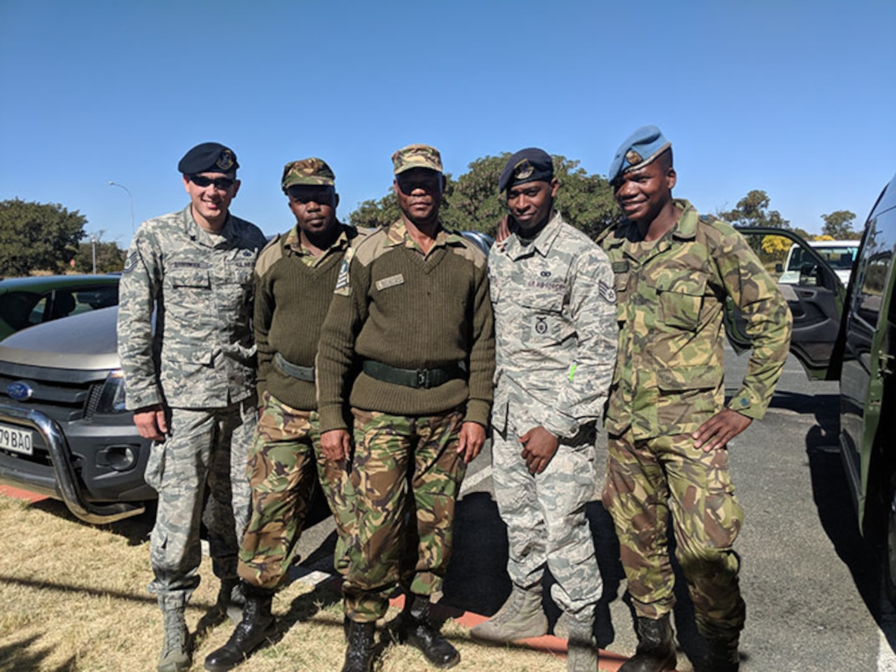 145th Airlift Wing Security Force Tech. Sgt. Adam Barringer, left, and Staff Sgt. Eric Stitt, second from right, pose for a picture with their Botswana Defense Force counterparts. North Carolina Air National Guard's 145th Airlift Wing Security Forces travelled to Botswana, Africa, in late June 2018, to work side-by-side with their Botswana Defense Air Force (BDF).