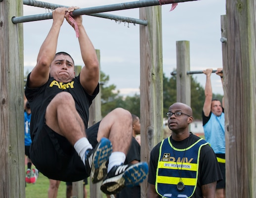 Spc. Efren Gandara performs leg tucks during a pilot for the Army Combat Fitness Test, a six-event assessment designed to reduce injuries and replace the current Army Physical Fitness Test.