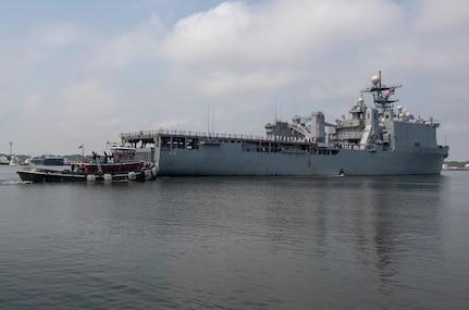 The Amphibious dock landing ship USS Gunston Hall gets underway from Virginia Beach.