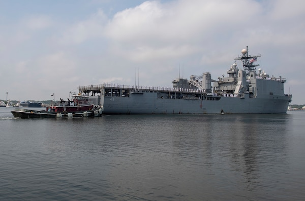 The Amphibious dock landing ship USS Gunston Hall gets underway from Virginia Beach.