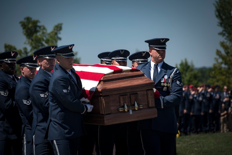 Members of the U.S. Air Force Honor Guard carry Capt. Mark Weber's casket during his funeral service, July 9, 2018, at Arlington National Cemetery, Va. Weber, a 38th Rescue Squadron combat rescue officer and Texas native, was killed in an HH-60G Pave Hawk crash in Anbar Province, Iraq, March 15. Friends, family, and Guardian Angel Airmen traveled from across the U.S. to attend the ceremony and pay their final respects. (U.S. Air Force photo by Staff Sgt. Ryan Callaghan)