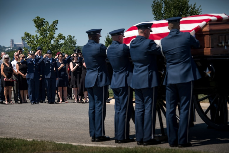 Friends and family of Capt. Mark Weber watch as his casket is transferred to a horse-led caisson during his funeral service, July 9, 2018, at Arlington National Cemetery, Va. Weber, a 38th Rescue Squadron combat rescue officer and Texas native, was killed in an HH-60G Pave Hawk crash in Anbar Province, Iraq, March 15. Friends, family, and Guardian Angel Airmen traveled from across the U.S. to attend the ceremony and pay their final respects. (U.S. Air Force photo by Staff Sgt. Ryan Callaghan)