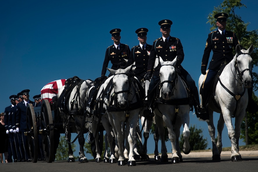 A horse-led caisson escorts the casket of Capt. Mark Weber during his funeral service, July 9, 2018, at Arlington National Cemetery, Va. Weber, a 38th Rescue Squadron combat rescue officer and Texas native, was killed in an HH-60G Pave Hawk crash in Anbar Province, Iraq, March 15. Friends, family, and Guardian Angel Airmen traveled from across the U.S. to attend the ceremony and pay their final respects. (U.S. Air Force photo by Staff Sgt. Ryan Callaghan)
