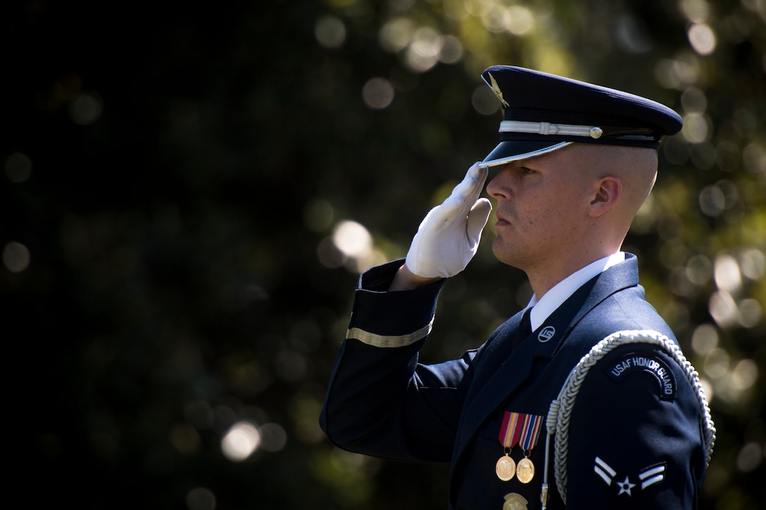 A U.S. Air Force Honor Guard ceremonial guardsman salutes Capt. Mark Weber's casket during his funeral service, July 9, 2018, at Arlington National Cemetery, Va. Weber, a 38th Rescue Squadron combat rescue officer and Texas native, was killed in an HH-60G Pave Hawk crash in Anbar Province, Iraq, March 15. Friends, family, and Guardian Angel Airmen traveled from across the U.S. to attend the ceremony and pay their final respects. (U.S. Air Force photo by Staff Sgt. Ryan Callaghan)