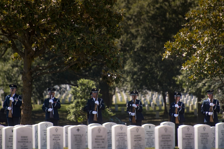 A firing-party from the U.S. Air Force Honor Guard stand ready during a funeral service for Capt. Mark Weber, July 9, 2018, at Arlington National Cemetery, Va. Weber, a 38th Rescue Squadron combat rescue officer and Texas native, was killed in an HH-60G Pave Hawk crash in Anbar Province, Iraq, March 15. Friends, family, and Guardian Angel Airmen traveled from across the U.S. to attend the ceremony and pay their final respects. (U.S. Air Force photo by Staff Sgt. Ryan Callaghan)