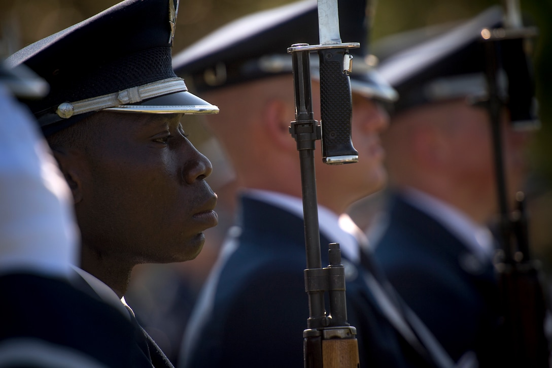 A U.S. Air Force Honor Guard ceremonial guardsman stands in formation during a funeral service for Capt. Mark Weber, July 9, 2018, at Arlington National Cemetery, Va. Weber, a 38th Rescue Squadron combat rescue officer and Texas native, was killed in an HH-60G Pave Hawk crash in Anbar Province, Iraq, March 15. Friends, family, and Guardian Angel Airmen traveled from across the U.S. to attend the ceremony and pay their final respects. (U.S. Air Force photo by Staff Sgt. Ryan Callaghan)