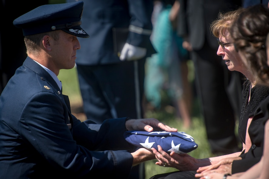 Maj. Jason Egger, 38th Rescue Squadron commander, presents a folded flag to the family of Capt. Mark Weber during his funeral service, July 9, 2018, at Arlington National Cemetery, Va. Weber, a 38th RQS combat rescue officer and Texas native, was killed in an HH-60G Pave Hawk crash in Anbar Province, Iraq, March 15. Friends, family, and Guardian Angel Airmen traveled from across the U.S. to attend the ceremony and pay their final respects. (U.S. Air Force photo by Staff Sgt. Ryan Callaghan)