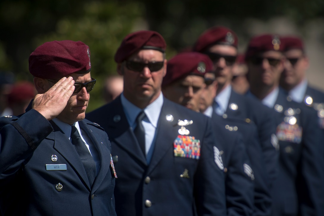 A combat rescue officer from the 103d Rescue Squadron salutes Capt. Mark Weber's casket during his funeral service, July 9, 2018, at Arlington National Cemetery, Va. Weber, a 38th Rescue Squadron combat rescue officer and Texas native, was killed in an HH-60G Pave Hawk crash in Anbar Province, Iraq, March 15. Friends, family, and Guardian Angel Airmen traveled from across the U.S. to attend the ceremony and pay their final respects. (U.S. Air Force photo by Staff Sgt. Ryan Callaghan)