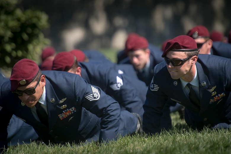 Guardian Angel Airmen perform memorial pushups following a funeral service for Capt. Mark Weber, July 9, 2018, at Arlington National Cemetery, Va. Weber, a 38th Rescue Squadron combat rescue officer and Texas native, was killed in an HH-60G Pave Hawk crash in Anbar Province, Iraq, March 15. Friends, family, and Guardian Angel Airmen traveled from across the U.S. to attend the ceremony and pay their final respects. (U.S. Air Force photo by Staff Sgt. Ryan Callaghan)
