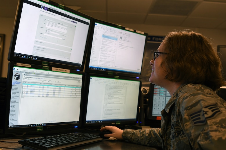 U.S. Air Force Staff Sgt. Kaylee Sprout, 81st Training Wing emergency action controller NCO in charge of systems, looks over emergency notification systems in the command post at Keesler Air Force Base, Mississippi, June 5, 2018. Emergency action controllers are responsible for receiving and disseminating information during emergencies. (U.S. Air Force photo by Airman 1st Class Suzie Plotnikov)