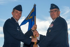 Col. Brian Musselman, right, accepts the 628th Medical Group guidon from Col. Jeffrey Nelson, 628th Air Base Wing commander, during a change of command ceremony in Nose Dock 2 July, 10, 2018. The ceremony also honored Lt. Col. Michael Lewis for his accomplishments as commander. The 16th AS commander is responsible for more than 150 combat crewmembers who execute C-17 Globemaster III airlift missions worldwide for DOD and National Command Authority directives. The change of command ceremony provides an opportunity for subordinates to witness the formal transfer of total responsibility, authority and accountability from one officer to the next.
