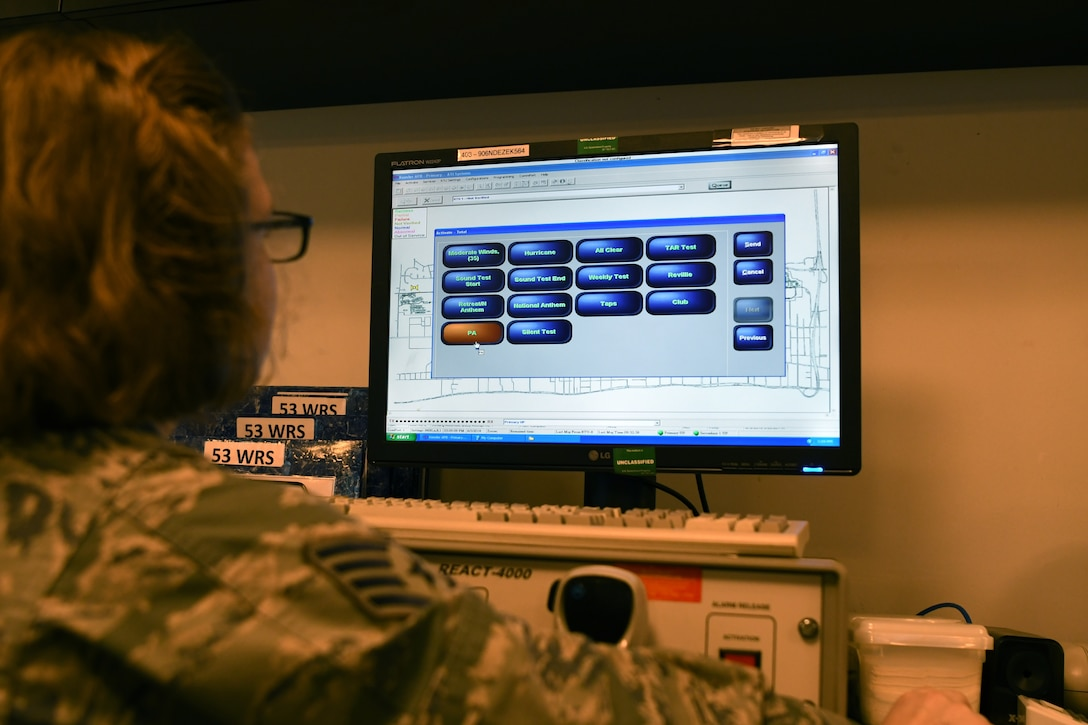 U.S. Air Force Staff Sgt. Kaylee Sprout, 81st Training Wing emergency action controller NCO in charge of systems, looks over the giant voice, an emergency notification system, in the command post at Keesler Air Force Base, Mississippi, June 5, 2018. Emergency action controllers are responsible for receiving and disseminating information during emergencies. (U.S. Air Force photo by Airman 1st Class Suzie Plotnikov)