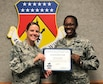 Master Sgt. Lauren Harston, 445th Logistics Readiness Squadron first sergeant, presents the April 2018 Diamond Sharp Award to Staff Sgt. Jameccia Haygood, 445th Logistics Readiness Squadron, during the June 9, 2018 unit training assembly. The award is for exemplary performance, adherence to the Air Force Core Values, attitude, appearance and ability.