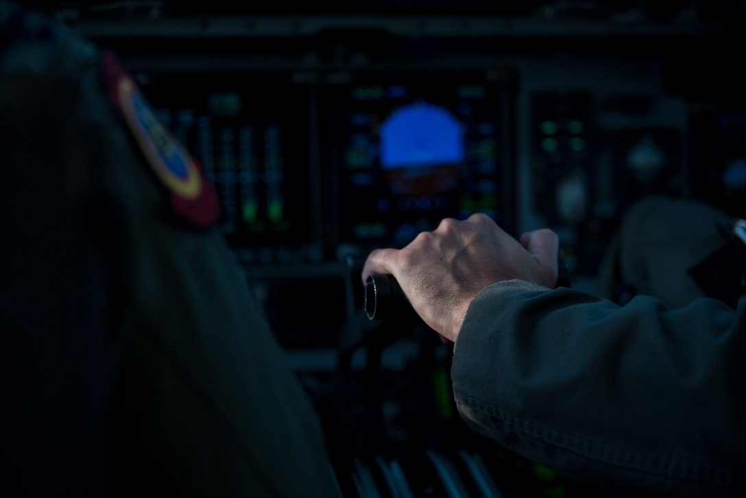 U.S. Air Force Capt. Sean Harte, 60th Air Mobility Wing Safety Office flight commander, flies a C-17 Globemaster III over California during a safety office familiarization flight July 2, 2018. The flight allowed Matt Stevens, a U.S. Department of Agriculture airport biologist, who helps manage the Bird/Wildlife Aircraft Strike Program at Travis Air Force Base, Calif., to get a firsthand view of what pilots see during training flights near the base. (U.S. Air Force photo by Master Sgt. Joey Swafford)