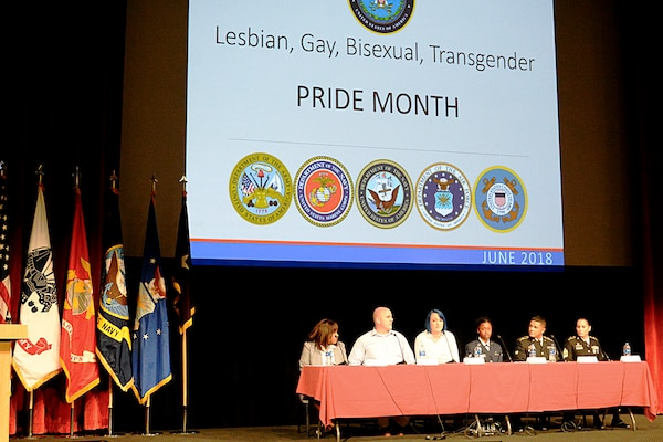"A Lesbian, Gay, Bisexual and Transgender panel answers questions June 29 during Brooke Army Medical Center's ""Educate the Force"" LGBT Pride Month observance at the Fort Sam Houston Theater. From left are Rev. Naomi Brown, vice chair of the San Antonio Pride Center and current director of training and education; Craig Wymer, retired Sgt. Kourtney Jones, Airman Kamicka Smalls, Spc. Hector Ortiz and 1st Sgt. Jessica Perez-Dixon."