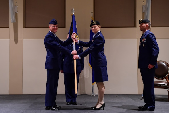 Maj. JenniferTitkemeier, 460th Security Forces Squadron commander, assumes command of the squadron June 28, 2018, on Buckley Air Force Base, Colorado. The 460th SFS provides security, law enforcement and force protection leadership to the personnel and resources of Buckley Air Force Base while maintaining and deploying a capability to defend our forces conducting wartime missions around the world. (U.S. Air Force photo by Airman 1st Class Holden S. Faul)