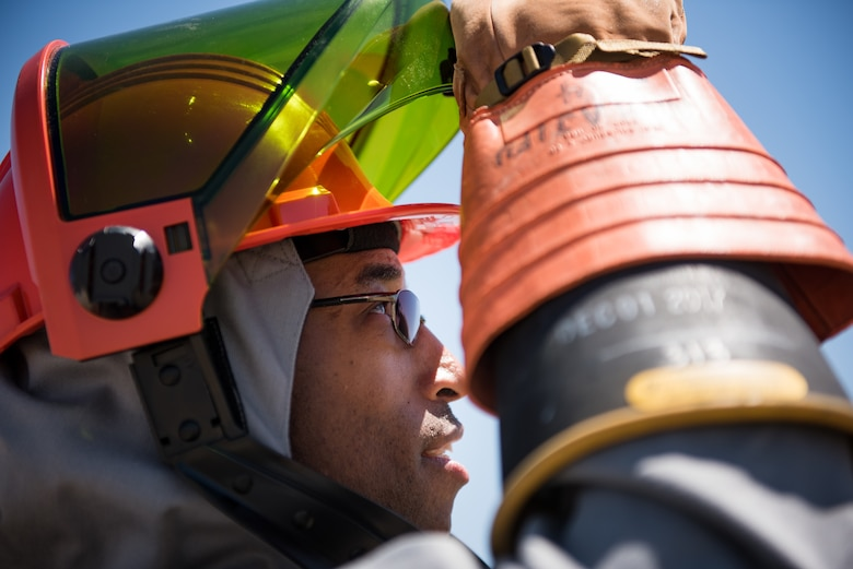 Staff Sgt. Alvin Walker, an electrical systems craftsman with the 137th Special Operations Civil Engineering Squadron (137th SOCES), Oklahoma City, lifts the visor on his hood of an arc flash suit during deployment readiness training at March Air Reserve Base in Moreno Valley, California, June 27, 2018. The 137th SOCES members train at a regional training site every three years as a part of this deployment readiness training. (U.S. Air National Guard photo by Staff Sgt. Brigette Waltermire)