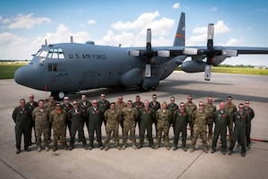 Loadmasters with the 182nd Operations Group, Illinois Air National Guard, pose for a group photo in front of a C-130H3 Hercules in Peoria, Ill., June 1, 2018.