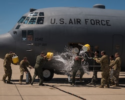 "U.S. Air Force Col. Timothy Stumbaugh, the commander of the 182nd Maintenance Group, Illinois Air National Guard, is soaked by colleagues at the completion of his ""fini flight"" in Peoria, Ill., June 4, 2018."