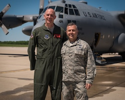 "U.S. Air Force Col. Timothy Stumbaugh, left, the commander of the 182nd Maintenance Group, Illinois Air National Guard, poses for a photo with 182nd Maintenance Group deputy commander Lt. Col. Steven Rice after Stumbaugh's ""fini flight"" in Peoria, Illinois, June 4, 2018."